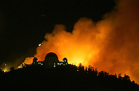 Griffith Park Observatory visible as flames approach. The fire has forced evacuation of residences of several neighborhoods surrounding Griffith Park near downtown Los Angeles May 8, 2007.