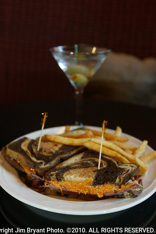 One of the District Lounge favorites, Hot Pastrami and a Gin Martini. The place is very cocktail lounge-y, dim, with overstuffed banquets and drop lighting.  Jim Bryant Photo. ©2010. All Rights Reserved.