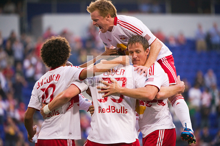 Kenny Cooper (33) of the New York Red Bulls celebrates scoring with teammates  during the first half against the Houston Dynamo during a Major League Soccer (MLS) match at Red Bull Arena in Harrison, NJ, on May 09, 2012.