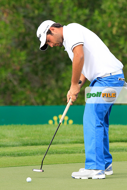 Alexander Levy (FRA) takes his putt on the 10th green during Sunday's Final Round of the Abu Dhabi HSBC Golf Championship 2015 held at the Abu Dhabi Golf Course, United Arab Emirates. 18th January 2015.<br /> Picture: Eoin Clarke www.golffile.ie