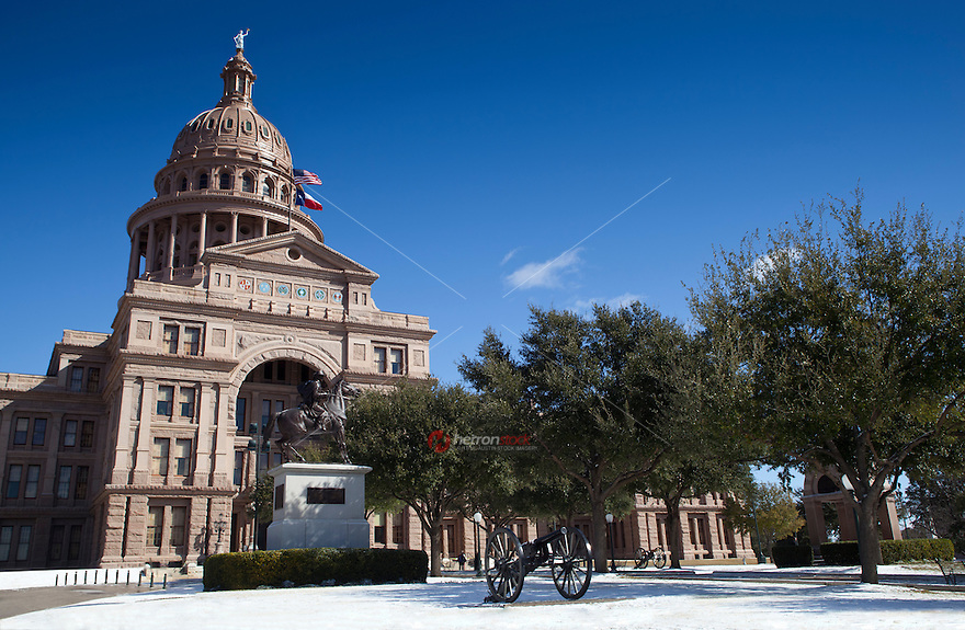 Beautiful Austin, Texas snow storm covers the Texas State Capitol grounds.