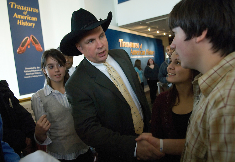 Country singer Garth Brooks talks to fans in the Smithsonian Air and Space Museum before a news conference where he donated items from his musical career to the National Museum of American History.