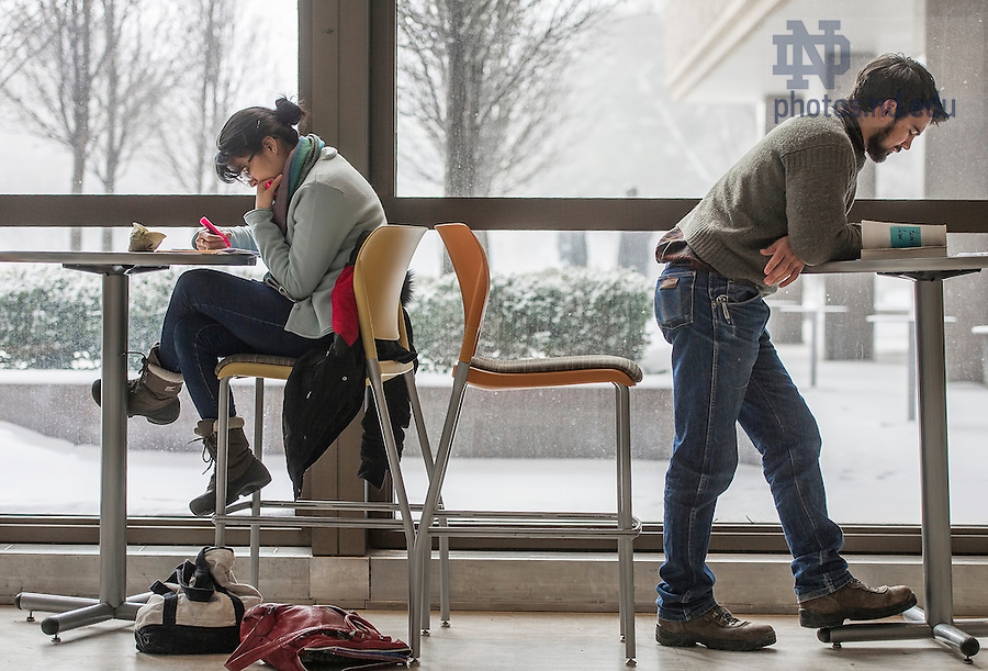 Feb. 18, 2015; Students study in the lobby of the Hesburgh Library.  (Photo by Barbara Johnston/University of Notre Dame)
