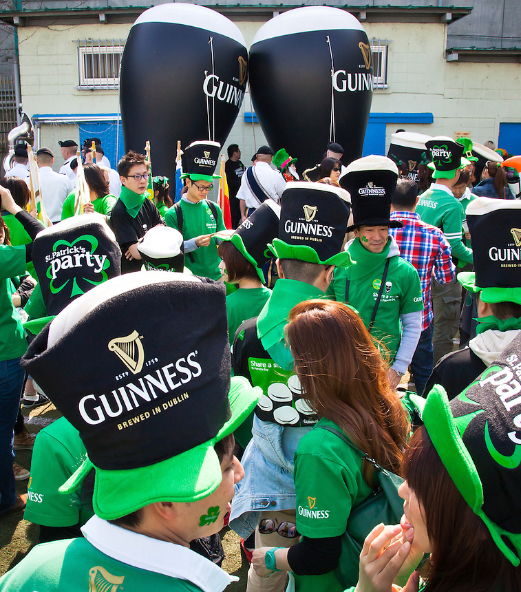 Tokyo St.Patrick`s day parade Guinness followers gather dressed appropriately for the occasion.