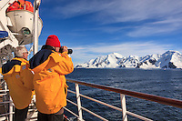 "A passenger of the ""Sea Spirit"" photographing the shorelines of Livingstone Island, in the South Shetland Islands near the Antarctic Peninsula."