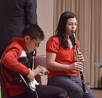 STAFF PHOTO BEN GOFF  @NWABenGoff -- 12/13/14 Isabelle Yumang, 12, and brother Ryan Yumang, 11, perform holiday tunes during the Will Bush Violin Studio holiday recital at the Shiloh Museum of Ozark History in Springdale on Saturday Dec. 13, 2014.