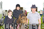 ALL SMILES: Emma, Clodagh and Michael Teahan, Glenbeigh were all smiles at the Killorglin Pony show on Sunday.
