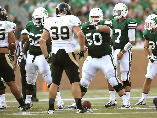 DENTON, TX - AUGUST 31: North Texas Mean Green quarterback Derek Thompson (7) of the North Texas Mean Green Football vs Idaho Vandals at Apogee Stadium in Denton on August 31, 2013 in Denton, Texas. Photo by Rick Yeatts