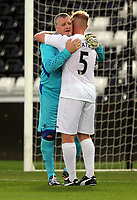 (L-R) Roger Freestone is embraced by team mate Alan Tate of Swansea during the Swansea Legends v Manchester United Legends at The Liberty Stadium, Swansea, Wales, UK. Wednesday 09 August 2017