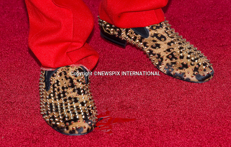 """FOOTWEAR FASHIONS - TYGA.The stars both the women and men put their best foot forward to display their varying foowear when they attended the 40th American Music Awards, Nokia Theatre, Los Angeles_18/11/2012.Mandatory Photo Credit: ©Francis Dias/Newspix International..**ALL FEES PAYABLE TO: """"NEWSPIX INTERNATIONAL""""**..PHOTO CREDIT MANDATORY!!: NEWSPIX INTERNATIONAL(Failure to credit will incur a surcharge of 100% of reproduction fees)..IMMEDIATE CONFIRMATION OF USAGE REQUIRED:.Newspix International, 31 Chinnery Hill, Bishop's Stortford, ENGLAND CM23 3PS.Tel:+441279 324672  ; Fax: +441279656877.Mobile:  0777568 1153.e-mail: info@newspixinternational.co.uk"""