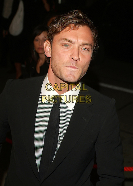 "JUDE LAW.At ""All The Kings Men"" Press Premiere during the 2006 Toronto International Film Festival held at Roy Thomson Hall, Toronto, Ontario, Canada,10 September 2006..half length black tie funny face mouth white striped pinstripe shirt.Ref: ADM/BP.www.capitalpictures.com.sales@capitalpictures.com.©Brent Perniac/AdMedia/Capital Pictures."