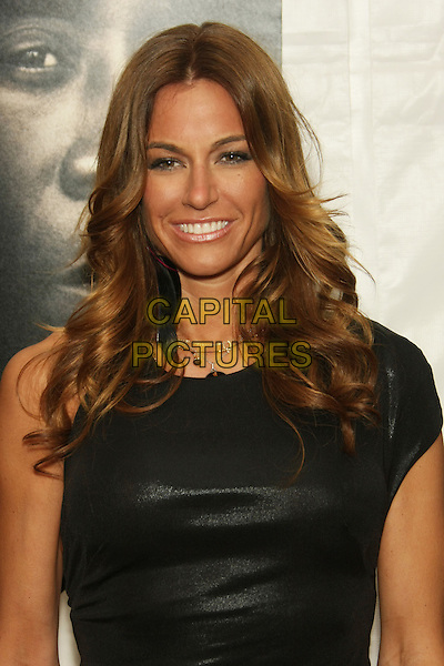"""KELLY BENSIMON.The New York Premiere of """"Brooklyn's Finest"""" held at the AMC Loews Lincoln Square Theatre, New York, NY, USA..March 2nd, 2010.half length black dress headshot portrait smiling leather sleeveless .CAP/LNC/TOM.©LNC/Capital Pictures."""