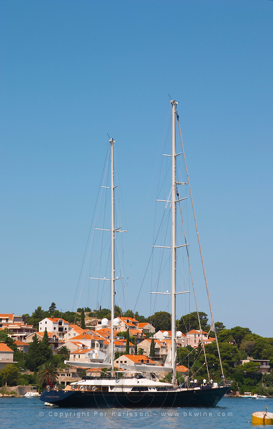 A very big luxurious pleasure sailing ship yacht with two masts, called Santa Maria leaving harbour. Luka Gruz harbour. Babin Kuk peninsula. Dubrovnik, new city. Dalmatian Coast, Croatia, Europe.