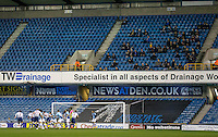 The travelling Wycombe Wanderers fans watch on during the Checkatrade Trophy round two Southern Section match between Millwall and Wycombe Wanderers at The Den, London, England on the 7th December 2016. Photo by Liam McAvoy.