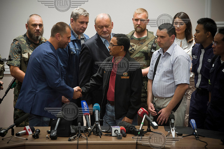 Aleksandr Borodai, selfproclaimed prime minister of the Donetsk People's Republic, shakes the hand of Colonel Mohamed Shakry of the Malaysian National Security Council after handing over the black boxes of flight MH17. The Malaysian Airlines flight came down in rebel held territory in Eastern Ukraine's Donetsk region on 17 July 2014. It is suspected that a surface to air missile was fired from rebel held positions which brought the plane down. In a long speech Borodai claimed that the separatists didn't have anything to do with downing flight MH17.