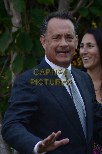 Tom Hanks.Circle Of Hope Dinner And Entertainment Gala held at Beverly Hills Hotel, Beverly Hills, California, USA..September 19th, 2012.half length black suit white shirt grey gray tie moustache mustache facial hair hand arm mouth open.CAP/ADM/TW.©Tonya Wise/AdMedia/Capital Pictures.
