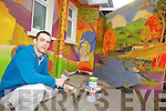MURALS: Killorglin artist, Colm McShane who has painted a colourful mural at the Killorglin Family Resource Centre and is planning further murals around the town.