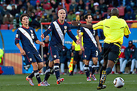 Francisco Torres (L) and Michael Bradley (R) of USA gesture towards the referee Koman Coulibaly