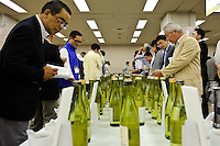 Japan Sake Fair 2009, Ikebukuro Sunshine City, Tokyo, Japan, June 17, 2009. During the annual Japan Sake Fair prize winning sake from all over Japan is presented for members of the public to taste.