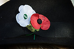 © Joel Goodman - 07973 332324 . 09/11/2014 .  Salford , UK . A white poppy , signifying remembrance of the civilian as well as military casualties of all wars , alongside a red poppy , worn on a woman's hat . Remembrance Sunday memorial service at the cenotaph in front of Salford Town Hall in Swinton . Photo credit : Joel Goodman