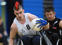 27 MAY 2013 - DONCASTER, GBR - David Anthony of the South Wales Pirates steers himself to the goal line during the 2013 Great Britain Wheelchair Rugby Nationals bronze medal match against the West Coast Crash at The Dome in Doncaster, South Yorkshire, Great Britain (PHOTO (C) 2013 NIGEL FARROW)