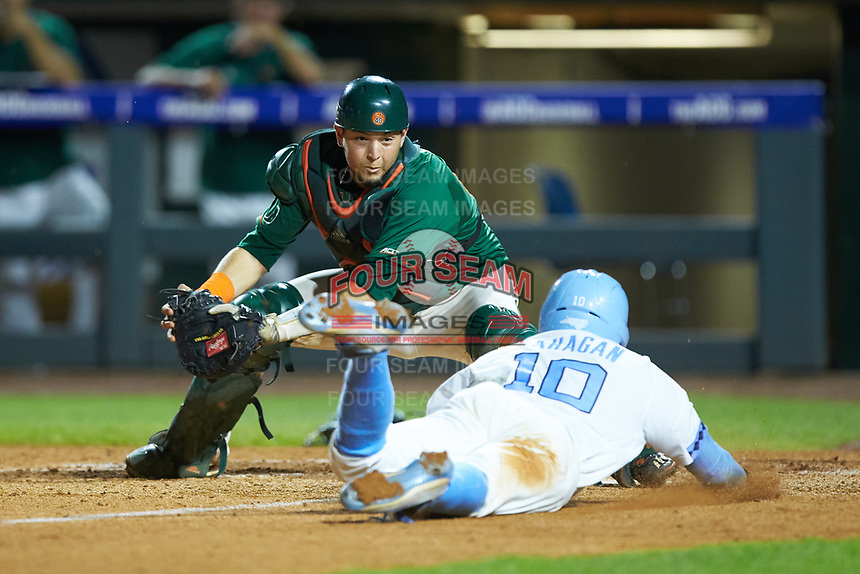 Miami Hurricanes catcher Joe Gomez (40) prepares to apply a tag to Zack Gahagan (10) of the North Carolina Tar Heels during the second semifinal of the 2017 ACC Baseball Championship at Louisville Slugger Field on May 27, 2017 in Louisville, Kentucky. The Tar Heels defeated the Hurricanes 12-4. (Brian Westerholt/Four Seam Images)