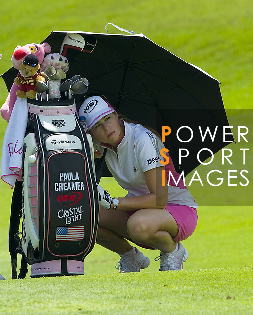 SINGAPORE - MARCH 06:  Paula Creamer of the USA cover herself with an umbrella as waits to play her shot during the second round of HSBC Women's Champions at the Tanah Merah Country Club on March 6, 2009 in Singapore. Photo by Victor Fraile / The Power of Sport Images