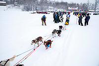 Chandler Wappett runs down the trail during the start of the 2018 Junior Iditarod Sled Dog Race on Knik Lake in Southcentral, Alaska.  Saturday February 24, 2018<br /> <br /> Photo by Jeff Schultz/SchultzPhoto.com  (C) 2018  ALL RIGHTS RESERVED