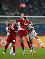 Clare Rustad, Carli Lloyd. The USWNT defeated Canada in extra time, 2-1, during the 2008 Beijing Olympics in Shanghai, China.