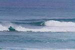 A large, north swell hitting Honolua Bay on the north shore of Maui, Hawaii, USA