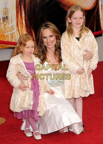 """MELORA HARDIN & DAUGHTERS .""""Hannah Montana: The Movie"""" Los Angeles Premiere held at the El Capitan Theatre, Hollywood, CA, USA, .2nd April 2009. .half length crouching bending fur leopard print beige coats family white dress matching .CAP/ADM/BP.©Byron Purvis/Admedia/Capital PIctures"""