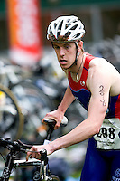 03 MAY 2009 - CALNE,GBR - Guest competitor Robert Bowles heads out of transition - BUCS Sprint Triathlon Championships '09 .(PHOTO (C) NIGEL FARROW)