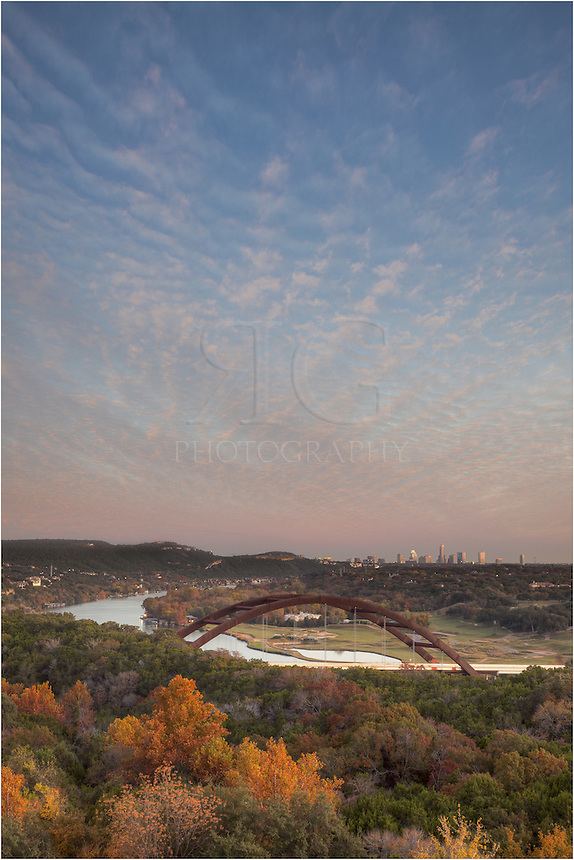 A November Evening falls over the 360 Bridge and Downtown Austin. Also called Pennybacker Bridge, this Austin icon is usually pretty crowded on weekend evenings like this.