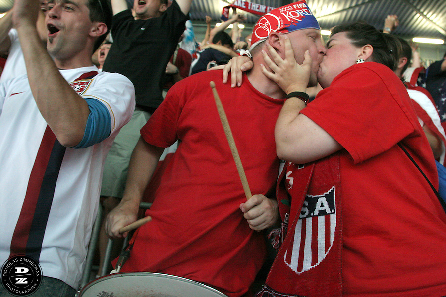 USA National Soccer Team fans Janice Harris and Kevin Lindstrom of Dallas, Texas kiss while celebrating the USA's goal in their FIFA World Cup First round match against Italy on Saturday June 17th, 2006 in Kaiserslautern, Germany.  The USA and Italy tied 1-1.