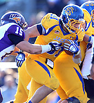 BROOKINGS, SD - OCTOBER 26:  Zach Zenner #31 from South Dakota State University slips out of the grasp of Tate Omli #15 from Northern Iowa in the second quarter of their game Saturday afternoon at Coughlin Alumni Stadium in Brookings. (Photo by Dave Eggen/Inertia)