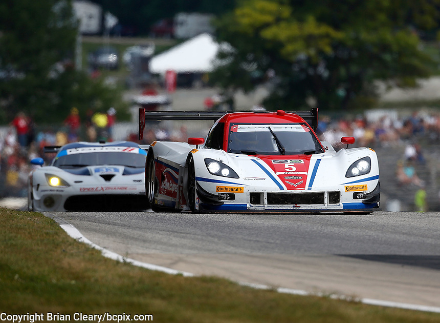 #5 Corvette DP of Joao Barbosa and Christian Fittipaldi, IMSA Tudor Series Race, Road America, Elkhart Lake, WI, August 2014.  (Photo by Brian Cleary/ www.bcpix.com )