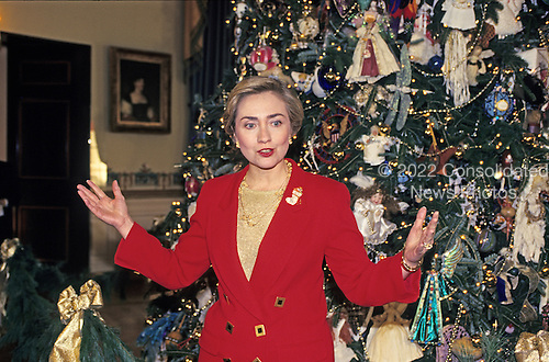 First lady Hillary Rodham Clinton makes remarks in the Blue Room as she stands in front of the 1993 White House Christmas tree during a press event to preview the holiday decorations at the White House in Washington, D.C. on December 6, 1993.<br /> Credit: Ron Sachs / CNP