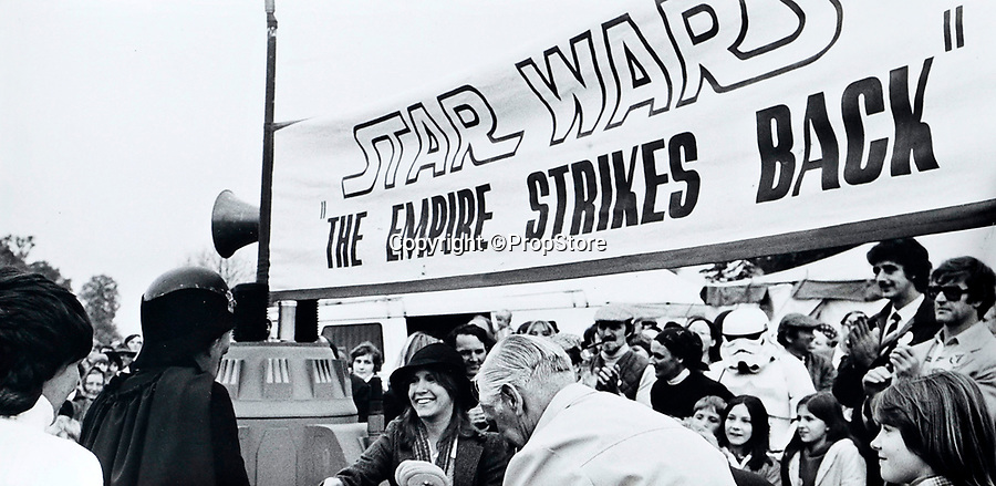 BNPS.co.uk (01202 558833)<br /> Pic: PropStore/BNPS<br /> <br /> Carrie Fisher was promoting the 2nd Star Wars film which was yet to be made - two Stormtroopers and Chewbacca actor Peter Mayhew also attended.<br /> <br /> A Stormtrooper helmet from the first Star Wars film has sold for almost £200,000 by a relative of a British country squire.<br /> <br /> Captain Robert Hawkins and his wife Anne were gifted the iconic helmet for staging the Star Wars Cross Country Team Event at their English manor house in 1978.<br /> <br /> The bizarre equestrian event was attended by Carrie Fisher, who played Princess Leia, Darth Vader actor David Prowse, Peter Mayhew, who played Chewbacca, and football pundit Jimmy Hill.