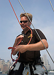 Bjarne Lorenzen prepares a knot prior to climbing the mast of the Tutima DK-46 sailing yacht during a sail along NY Harbor Friday, June 8, 2007 in Manhattan. The German based 46 foot yacht was visiting New York prior to its 3600 mile race across the atlantic ocean which begins June 16, 2007 in Newport, R.I. (Photo/ Victoria Arocho, Rocka*Rho Publishing)