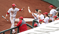 Austin Cangelosi (18) is congratulated by teammates after scoring in the third inning of the Hoosiers' 5-3 loss to Maryland in the opening game of the Big Ten Tournament at TD Ameritrade Park in Omaha, Neb. on May 25, 2016. (Photo by Michelle Bishop)