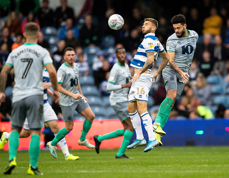 Blackburn Rovers' Derrick Williams (right) competing with Queens Park Rangers' Jan Mlakar (2nd right) in the air<br /> <br /> Photographer Andrew Kearns/CameraSport<br /> <br /> The EFL Sky Bet Championship - Queens Park Rangers v Blackburn Rovers - Saturday 5th October 2019 - Loftus Road - London<br /> <br /> World Copyright © 2019 CameraSport. All rights reserved. 43 Linden Ave. Countesthorpe. Leicester. England. LE8 5PG - Tel: +44 (0) 116 277 4147 - admin@camerasport.com - www.camerasport.com
