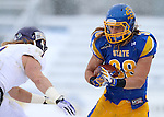 BROOKINGS, SD - NOVEMBER 15: Jake Gentile #38 from South Dakota State University looks to slip past Joey Borsellino #1 from Western Illinois after an interception in the second quarter Saturday afternoon at Coughlin Alumni Stadium in Brookings. (Photo by Dave Eggen/Inertia)