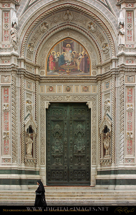 Nun walking past Main Portal Santa Maria del Fiore Florence