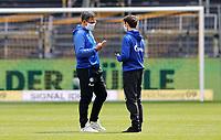 16th May 2020, Signal Iduna Park, Dortmund, Germany; Bundesliga football, Borussia Dortmund versus FC Schalke;  S04 Trainer David Wagner chats with S04 Benito Raman in a Mask per the new DFL Ruleand