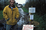 Matt Knight an organic farmer in Chulmleigh, Devon barricaded himself and his family  in to their farm; claiming that the vacination route  to solving the foot and mouth outbreak had not been  explored enough.  .Foot and mouth outbreak, UK  2001.