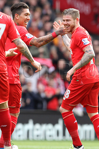 10.04.2016. Anfield, Liverpool, England. Barclays Premier League. Liverpool versus Stoke. Roberto Firmino of Liverpool congratulates Alberto Moreno of Liverpool for his blast for the first goal.