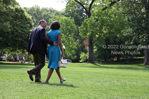 United States President Barack Obama and first lady Michelle Obama, walk on the South Lawn of the White House as they prepare to depart for a day trip to Ohio and Virginia for the first official campaign rallies of the 2012 election season, in Washington, D.C., Saturday, May 5, 2012..Credit: Martin Simon / Pool via CNP