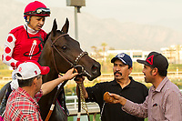 ARCADIA, CA  JANUARY 07: #8 Midnight Bisou, ridden by Mike Smith, gets sponged off after winning  the Santa Ynez Stakes (Grade ll) on January 7, 2018, at Santa Anita Park in Arcadia, CA. (Photo by Casey Phillips/ Eclipse Sportswire/ Getty Images)