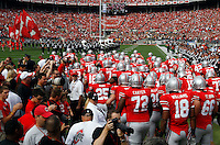 Ohio State football team make their way on to the field for their game against the Colorado Buffaloes at the Ohio Stadium in Columbus, September 25, 2011.  (Dispatch photo by Neal C. Lauron)