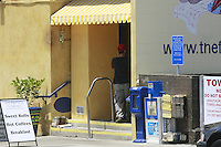 May 15 2008, Pacific Beach, San Diego, CA, USA:  A plain-clothes ICE agent enters the French Gourmet resturant on Turquoise Street after it was rraided earlier in the day. Eyewitnesses said that the street was closed for a block or two during the raid just before 8am.